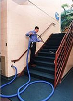 man using Spencer floor cleaning attachment