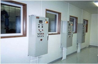 3 control cabinets mounted on the wall